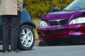 Image of Gentleman Looking at Car Damaged in Accident