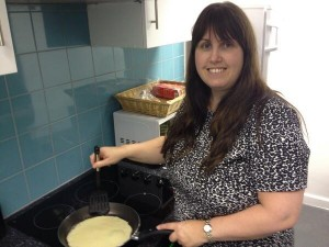 Naomi Wilson making pancakes for all the staff